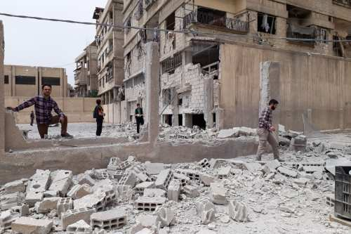 Syrians inspect the debris after the Assad Regime carried out airstrike hit Damascus, Syria on1 May 2017 [Samir Tatin/Anadolu Agency]