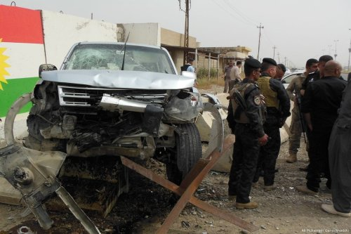 A damaged vehicle is seen after a gun attack which killed a senior official of Iraq's state-run North Gas Company (NGC), in Kirkuk, Iraq on 2 May 2017 [Ali Mukarrem Garip/Anadolu Agency]