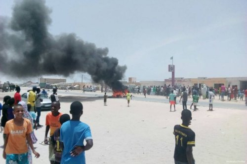 A fire broke out during a demonstration against slavery in Mauritania on 30 April 2017 [Weddady/Twitter]