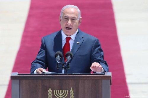 Israeli Prime Minister Benjamin Netanyahu (R) speaks upon US President Trump's arrival in Tel Aviv on 22 May, 2017 [Daniel Bar On/Anadolu Agency]
