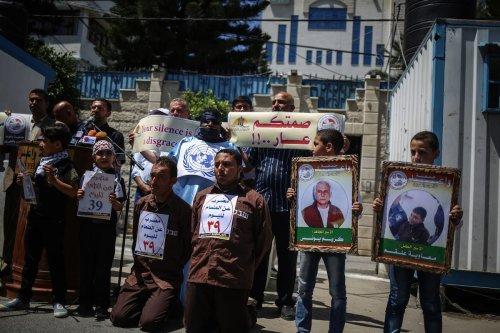 Palestinian demonstrators hold placards during a demonstration in support Palestinian prisoners held in Israeli jails in Gaza City, Gaza on May 25, 2017 [Ali Jadallah/Anadolu Agency]