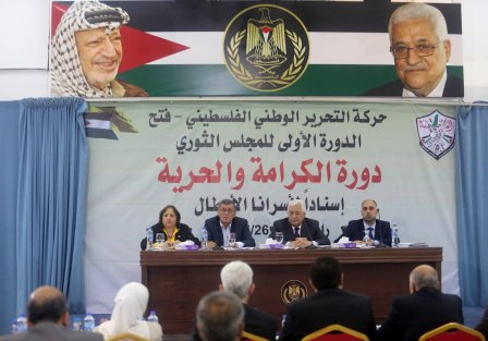 Palestinian President Mahmoud Abbas (2nd R) and Secretary of the Revolutionary Council of the Fatah movement, Majed Al Fityani (2nd L) attend a Revolutionary Council Meeting of Fatah Movement in Ramallah, West Bank on May 25, 2017 [Issam Rimawi/Anadolu Agency]