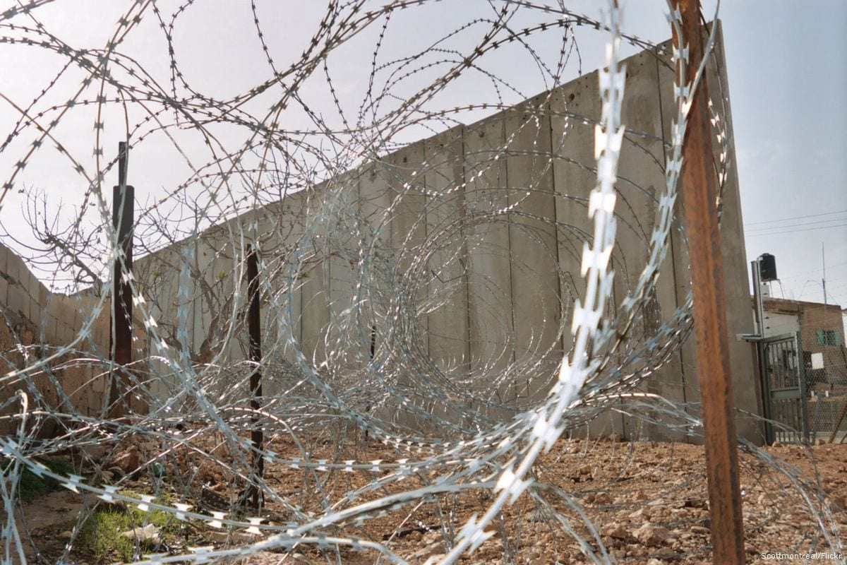Image of the Israeli wall along the West Bank which isolates the Palestinians and keep them confined in their own land [Scottmontreal/Flickr]