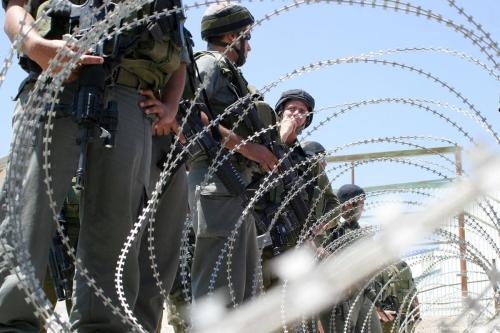 Israeli soldiers monitor a demonstration by Palestinians in Bethlehem, West Bank on 12 June 2012 [Najeh Hashlamoun/Apaimages]