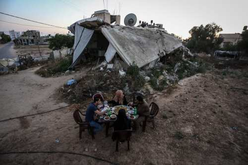 Semahir, member of the Palestinian Sahin family feeds her 8 months baby Selma as they break their fast, during the Muslim Holy month of Ramadan in eastern part of wrecked Abasan Al-Kabira town of Khan Younis, in Gaza City, Gaza on May 28, 2017. Ali [Jadallah - Anadolu Agency ]