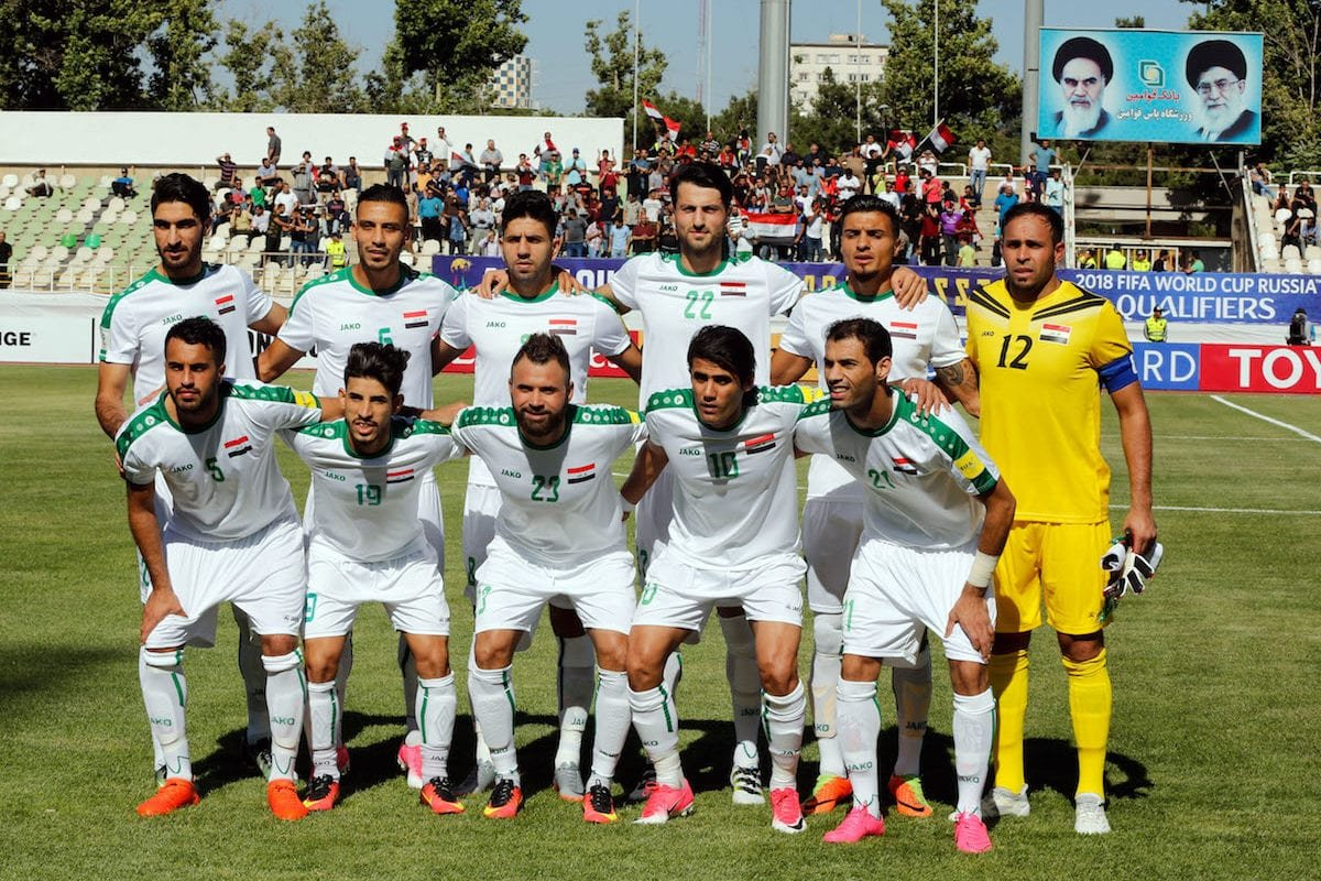 Iraq National Fooball team pose for a team photo ahead of the 2018 FIFA World Cup Asian Qualifying group B football match between Iraq and Japan at Shahid Dastgerdi Stadium in Tehran, Iran on June 13, 2017 [Stringer / Anadolu Agency]