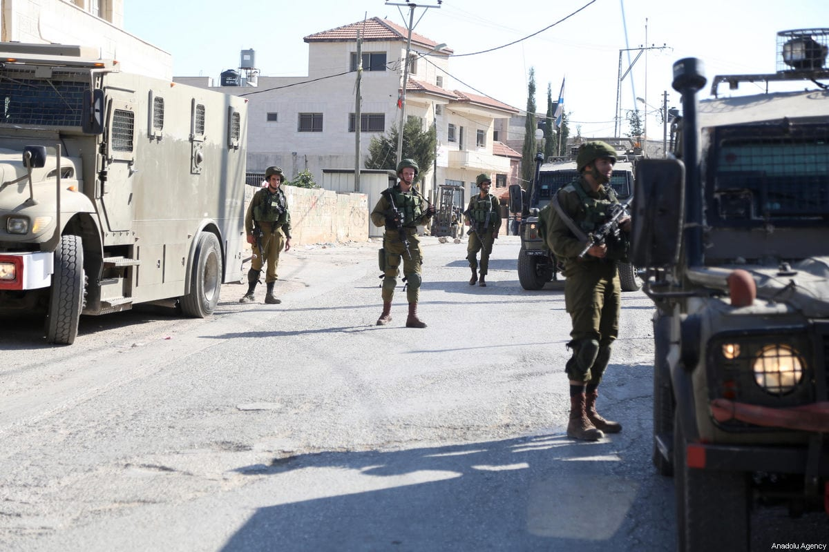 Israeli soldiers launch raid houses of the three Palestinians who were killed after they had allegedly attempted to attack the Israeli soldiers, in Deir Abu Mash'al village, Ramallah, West Bank on June 17, 2017 [Issam Rimawi / Anadolu Agency]