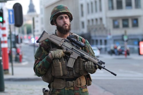 An armed soldier stands guard outside of the Brussels Central Station on 20 June 2017 [Dursun Aydemir/Anadolu Agency]