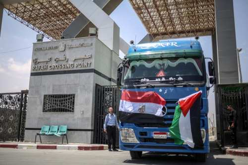 Oil trucks enter the Gaza Strip from the Rafah border crossing as part of the triple agreement between Egypt, Hamas and Mohammed Dahlan, in Rafah, Gaza on 21 June 2017 [Ali Jadallah/Anadolu Agency]
