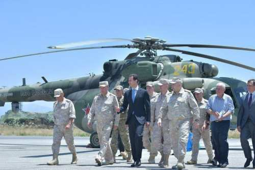 Syrian President Basher al-Assad seen touring a Russian air base at Hmeymim in western Syria on June 27, 2017 [Sana / Telegram]