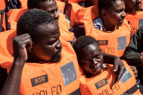 Migrants wait for transferring from NGO ship Juventa to Spansih NGO Proactiva Open Arms after being rescued in the Mediterranean Sea, 23 miles north the coast of Sabratha on 20 June, 2017 [Marcus Drinkwater/Anadolu Agency]