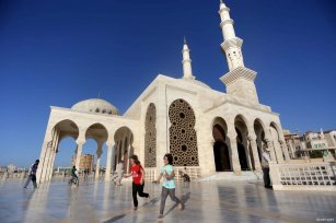 GAZA CITY, GAZA- Children play in the courtyard of the newly built Al-Khaldi Mosque
