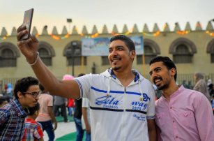 Egyptians take a selfie as they attend the morning prayers for Eid al-Fitr celebrations, which marks the end of the holy fasting month of Ramadan, in Cairo, Egypt, on June 25, 2017. Photo by Amr Sayed