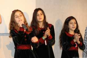A group singing performance as part of the evening entertainement at the Palestine Expo. [Image: Jehan Al-Farra / Middle East Monitor]