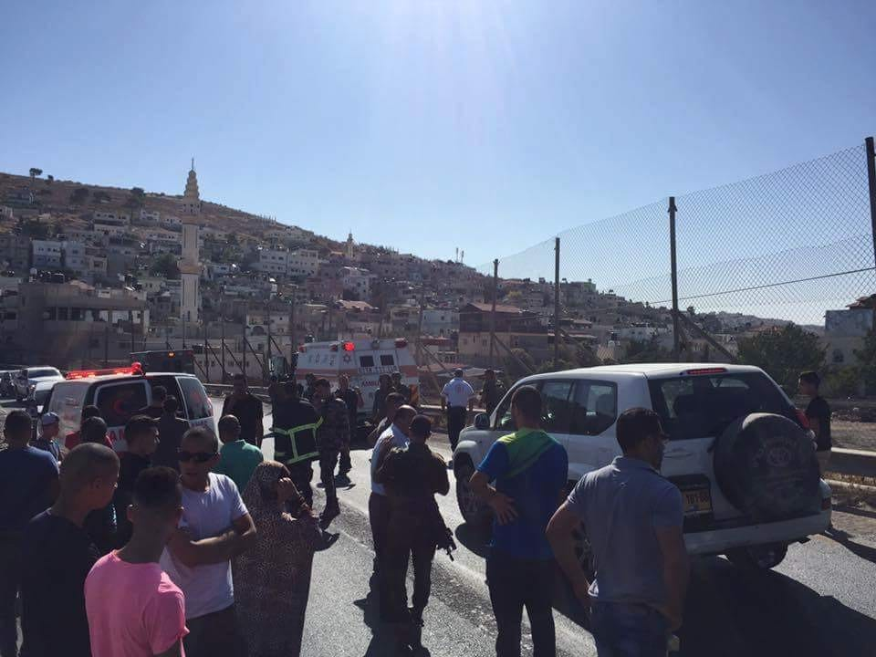 People gathered at the scene after a Palestinian girl was left wounded by a hit-and-run incident by an Israeli settler in Hebron [PalInfo]
