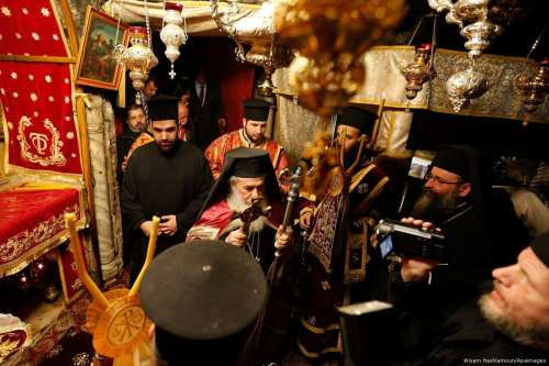 Image of the Greek Orthodox Patriarch of Jerusalem Theophilos III is seen inside the Church of the Nativity in Bethlehem, West Bank on 6 January 2017 [Wisam Hashlamoun/Apaimages]