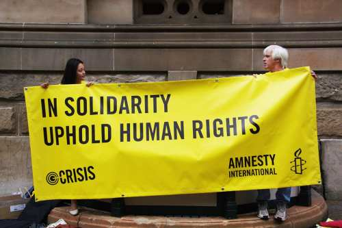 Image of an Amnesty International rally [Richard Potts/Flickr]