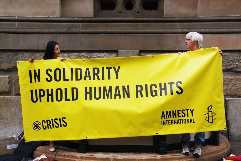 Image of an Amnesty International rally [Richard Potts/Flickr]