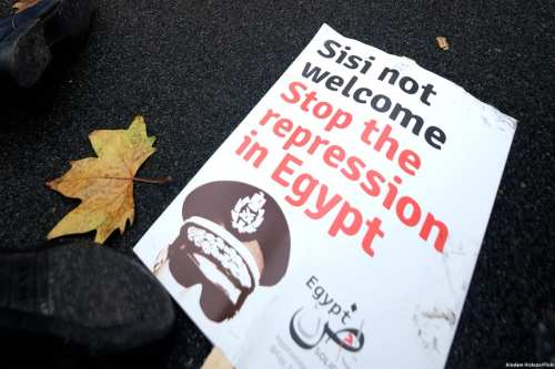 Image of a poster condemning the Egyptian President Abdel Fattah al-Sisi [Alisdare Hickson/Flickr]