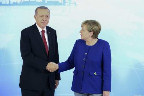 German Chancellor Angela Merkel (R) shakes hand with President of Turkey, Recep Tayyip Erdogan (L) as she welcomes him prior to G20 Leaders' Summit at Hotel Atlantic Kempinski in Hamburg, Germany on July 06, 2017 [Halil Sağırkaya / Anadolu Agency]