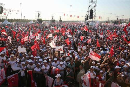 People wave the Turkish flag as leader of the main opposition, Kemal Kilicdaroglu, delivers a speech in Istanbul, Turkey on 9 July 2017 [Onur Çoban/Anadolu Agency]