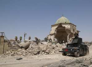The Great Mosque of al-Nuri and al-Hadba minaret are seen in in Mosul after the city was freed from Daesh on 9 July 2017 [Hemn Baban /Anadolu Agency]