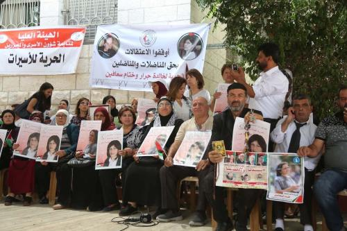 Palestinian families hold posters of their relatives as they gather for a demonstration to show their support for the Palestinian prisoners in Israeli jails, in front of International Committee of the Red Cross in Al Bireh, West Bank on 11 July, 2017 [Issam Rimawi/Anadolu Agency]
