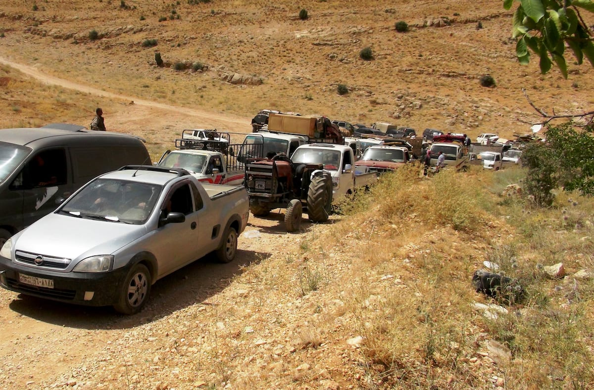 A vehicle convoy, carrying approximately a group of 100 Syrian refugee are seen on the way to back their home country in Arsal, district of Baalbek, Beqaa, Lebanon on July 12, 2017. ( Suleiman Amhaz - Anadolu Agency )