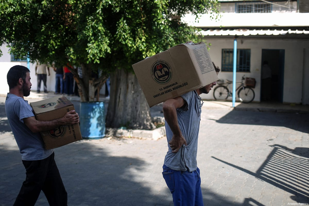 Humanitarian aid sent by Disaster and Emergency Management Presidency of Turkey (AFAD) and Turkish Cooperation and Coordination Agency (TIKA) are being distributed in Gaza City, Gaza on 16 July, 2017 [Ali Jadallah/Anadolu Agency]