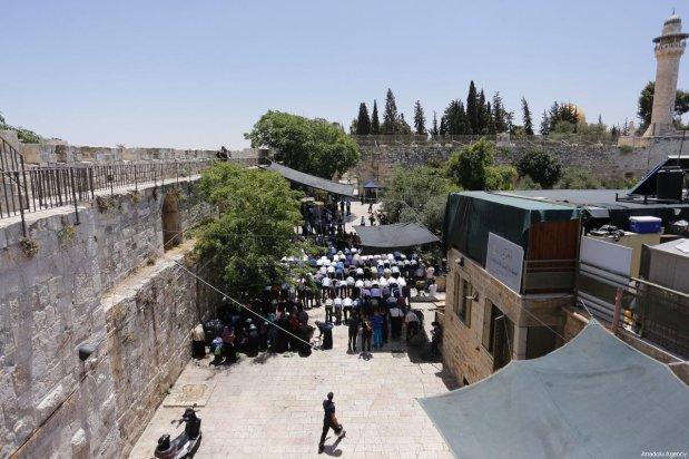 Palestinian worshippers perform prayers outside one of the main entrances to the Al-Aqsa mosque, refusing to enter because of new metal detectors installed at entrances as the holy site re-opened for the first time on Sunday since a two-day closure following a deadly shootout in Jerusalem on July 16, 2017 [Alkharouf Mostafa / Anadolu Agency]