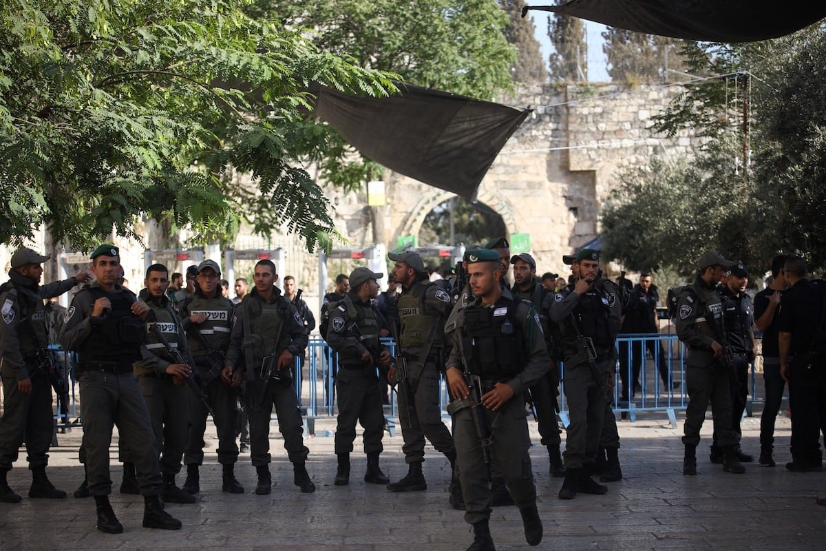 Israeli policemen seen at the entrances to Al-Aqsa mosque compound, in Jerusalem on July 16, 2017 [Mostafa Alkharouf / Anadolu Agency]