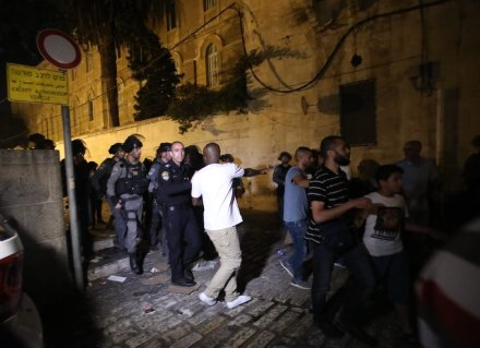 JERUSALEM - JULY 18 : Israeli security forces intervene the Palestinians after they performed night prayer as they refusing to enter because of the detectors installed by Israel outside of the main entrances to the Al-Aqsa mosque that re-opened for the first time on Sunday since a two-day closure following a deadly shootout in Jerusalem on July 18, 2017. Some protesters along with Al-Aqsa Mosque Ikrimah Sabri wounded during the intervention. ( Mostafa Alkharouf - Anadolu Agency )