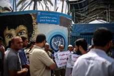 Demonstrators gather outside the UNRWA office to protest against the electricity crisis in Gaza on 19 July 2017 [Ali Jadallah/Anadolu Agency]