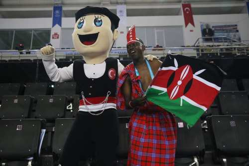 A mascot dances with a Kenyan wearing a traditional clothes during a basketball match between Turkey and Kenya within the 23rd Summer Deaflympics 2017 at Yasar Dogu Sports Center in Samsun, Turkey on 24 July, 2017 [Metin Aktas/Anadolu Agency]