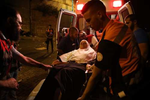 A Palestinian woman is being hospitalized due to Israeli security forces' intervention with plastic bullets, stun grenades and tears gas after Palestinians performed evening prayer in front of Al-Aqsa Mosque Compound's Lion Gate in Jerusalem on 25 July, 2017 [Mostafa Alkharouf/Anadolu Agency]