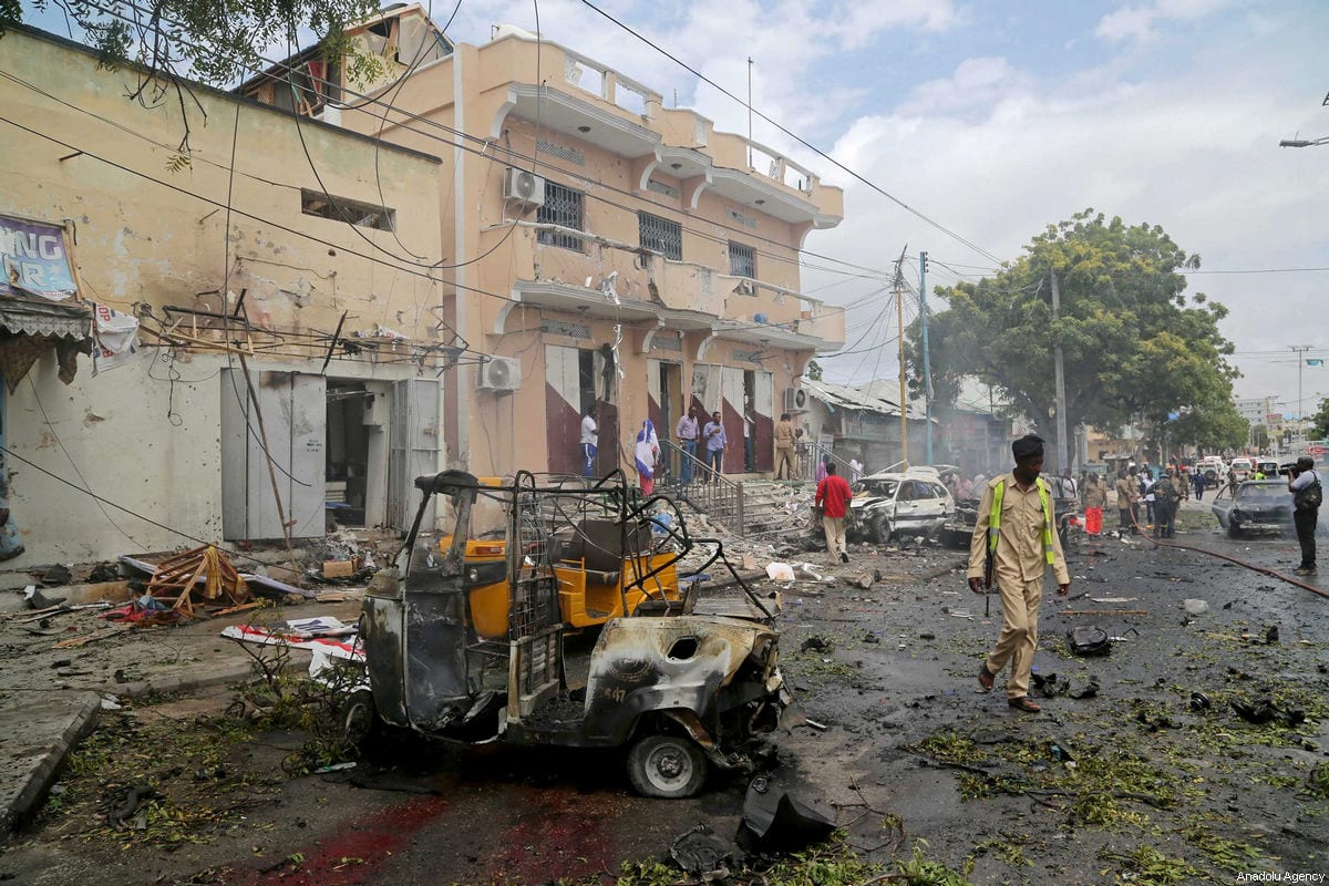 Somalians are seen near a vehicle at the site after bomb-laden vehicle attack at Waberi district in Mogadishu, Somalia on July 30, 2017 [Sadak Mohamed / Anadolu Agency]