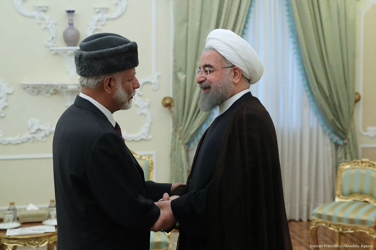 President of Iran, Hassan Rouhani (R) shakes hands with Omani Minister Responsible for Foreign Affairs, Yusuf bin Alawi bin Abdullah (L) at the Presidency Palace in Tehran, Iran on 12 July 2017 [Iranian Presidency/Handout/Anadolu Agency]