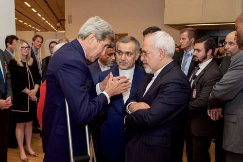 US Secretary of State John Kerry [L] speaks with Hossein Fereydoun [C], the brother of Iranian President Hassan Rouhani, and Iranian Foreign Minister Javad Zarif [R], before the Secretary and Foreign Minister addressed an international press corps gathered at the Austria Center in Vienna, Austria, on July 14, 2015 [State Department photo/ Public Domain]