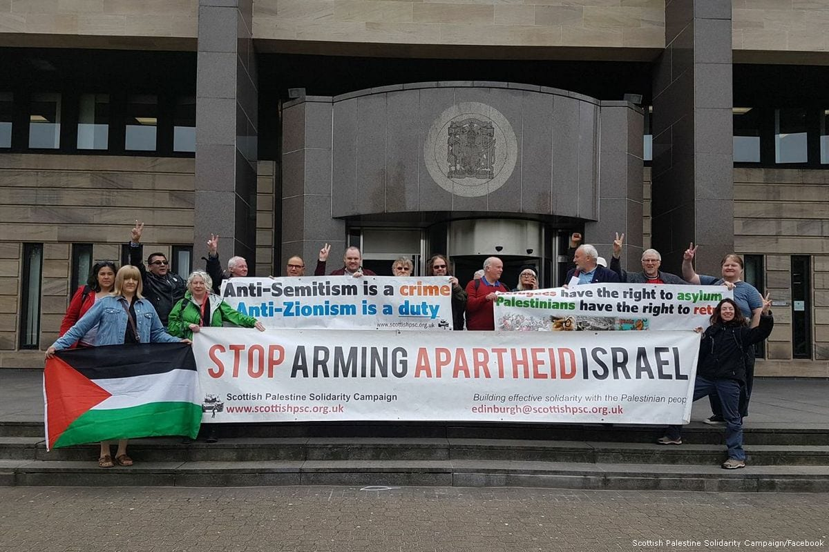Activist from the Scottish Palestine Solidarity Campaign protest Israel's violations of Palestinian rights outside the Glasgow Sheriff Court, Scotland on 10 July 2017 [Scottish Palestine Solidarity Campaign/Facebook]