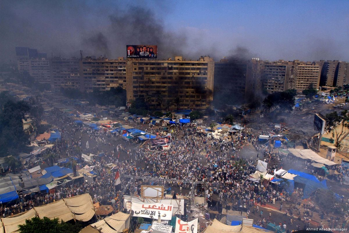 Smoke rises at Rabaa al-Adawya square following clashes between supporters of the ousted president Morsi and riot police in Cairo, Egypt on14 August 2013 [Ahmed Asad/Apaimages]