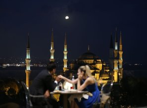 A couple watch the view as the Sultanahmet mosque is seen during the Partial Lunar Eclipse in Istanbul, Turkey on 7 August, 2017 [Yasin Aras/Anadolu Agency]