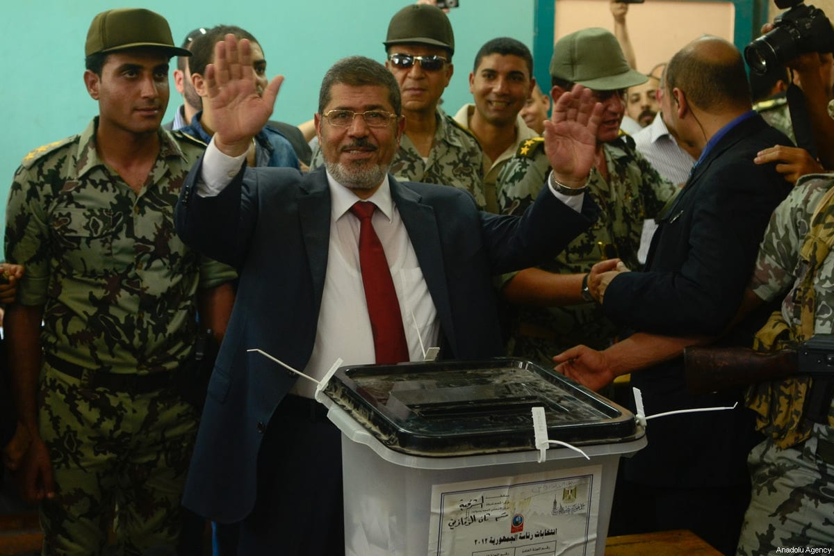 A file photo dated June 16, 2012 shows Mohammed Morsi gesturing after casting his vote in Sharkiya state during presidential elections in Sharqia, Egypt. ( Mohammed Elshamy - Anadolu Agency )