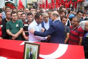 Turkish Interior Minister Suleyman Soylu consoles the family members of 15-year-old Eren Bulbul killed by PKK militants, during the funeral ceremony in Macka Province of Trabzon, Turkey on August 12, 2017 [Hakan Burak Altunöz / Anadolu Agency]