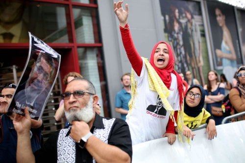 A girl gestures during a protest marking the fourth anniversary of Rabaa El Adaweya massacre in Times Square of Manhattan borough of New York, United States on 13 August 2017. [Mohammed Elshamy - Anadolu Agency]
