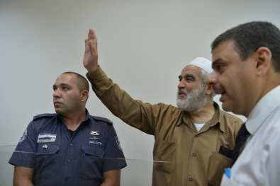 Leader of the Northern Branch of the Islamic Movement in Israel, Sheikh Raed Salah (2nd L) appears in court after he was taken under custody on the grounds that he allegedly provoked and supported an illegal association, in Rishon Lezion, Israel on 14 August , 2017 [Stringer/Anadolu Agency]