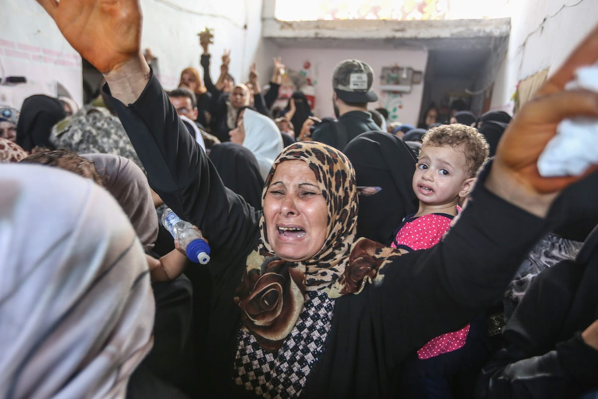 A woman mourns during the funeral ceremony of Nidal al-Jafari, border security officer who lost his life on the suicide attack carried out at Rafah Border Gate, in Rafah, Gaza on 17 August, 2017
