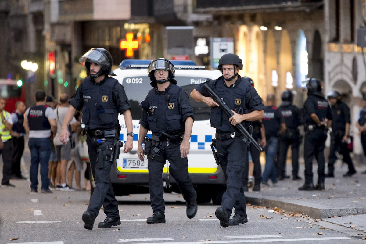 Police officers take security measures at the area after a van plowed into the crowd, injuring several people in Barcelona, Spain on 17 August, 2017 [Gorka Leiza/Anadolu Agency]