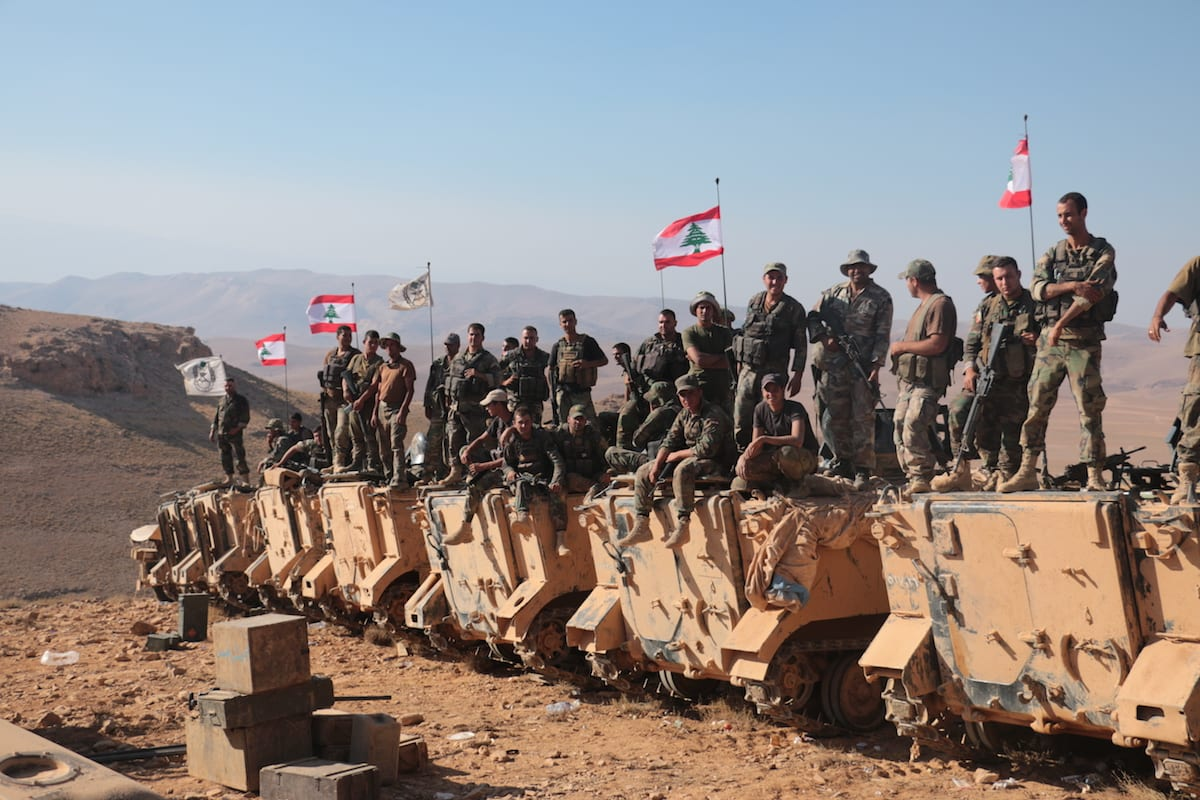 """Lebanese soldiers stand guard at the Lebanon-Syria border with armoured vehicles after the """"Dawn of the Mountains"""" operation against Daesh was completed on 28 August 2017 [Muhammed Ali Akman/Anadolu Agency]"""