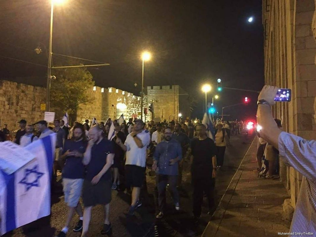 Settlers march through the streets of occupied East Jerusalem on 31 July, 2017 [Muhammad Smiry/Twitter]