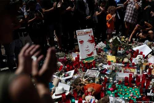 People gather and mourn at La Rambla boulevard for the victims those who lost their lives in terror attack killing at least 13 people when a white van ploughed into a crowd in central Barcelona, on 18 August, 2017, Barcelona, Spain [Burak Akbulut/Anadolu Agency]